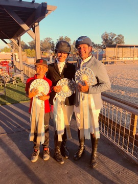 Nina and Mariano with their son, Nico, after a successful finish on three horses in the ribbons in the $40,000 Lugano Diamonds Grand Prix. Photo: Estancia Farms client